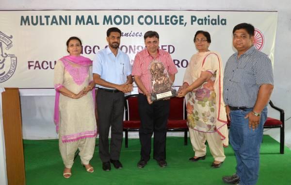 Presenting momento to Dr. Ashwani Kumar Bhalla, SCD Govt. College, Ludhiana