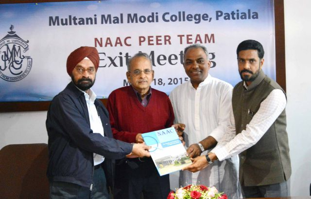 NAAC Peer Team Presenting Re-accreditation Report to College Pri