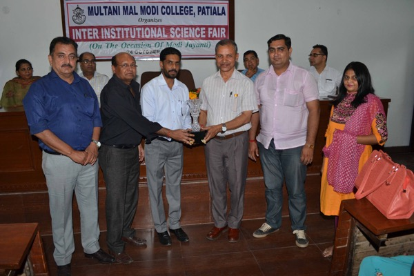 College Principal Dr. Khushvinder Kumar and Staff Members honouring chief guest Prof. N. S. Attri, Additional Dean, Research, Punjabi University, Patiala