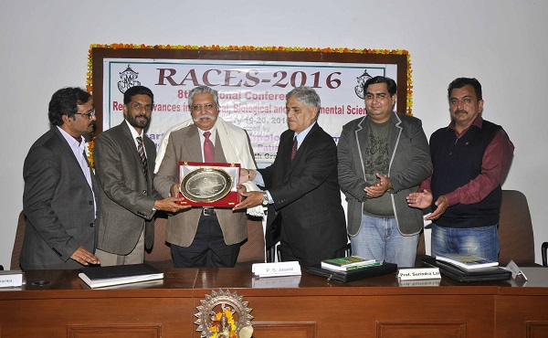 College Principal Dr. Khushvinder Kumar and Prof. Surindra Lal, Member Managing Committee felicitating the Chief Guest Prof. (Dr.) P. S. Jaswal, Vice Chancellor, Rajeev Gandhi National University of Law, Patiala