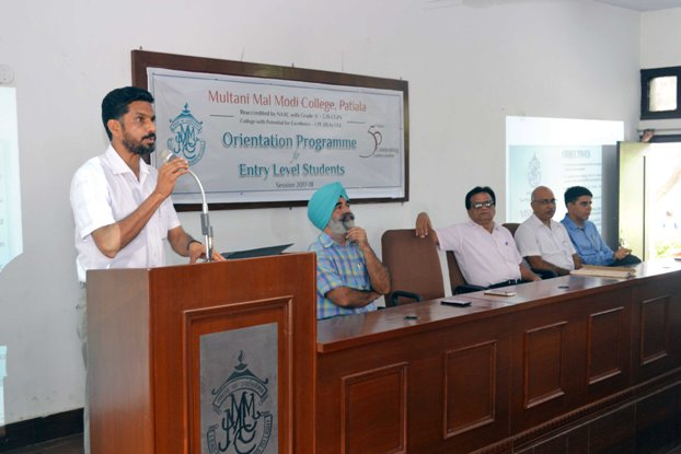 Principal Dr. Khushvinder Kumar addressing the students attending the Orientation Programme at M M Modi College, Patiala